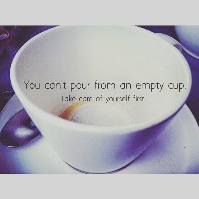 You can't pour from an empty cup, Take care of yourself first in black with an empty coffee mug in a wite plate with a spoon on it..